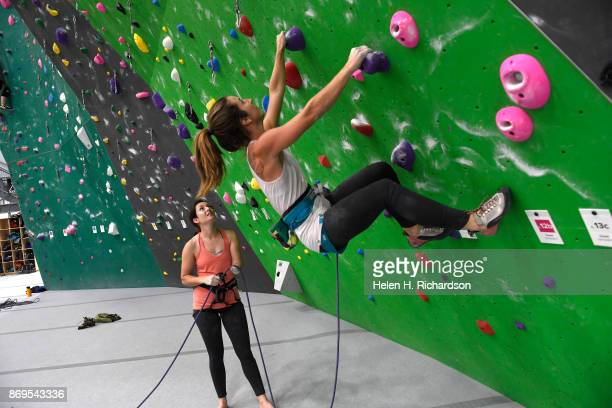 LOUISVILLE CO OCTOBER 25 Maureen Beck left belays her climbing partner Sarah Fountain right as she begins a climb on the overhanging wall at EVO Rock...