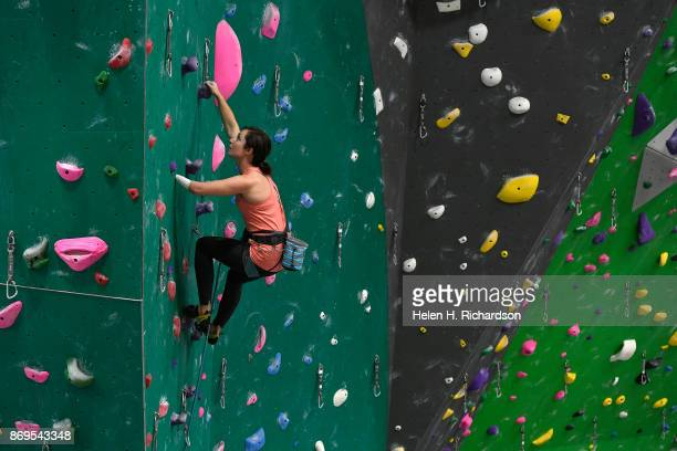 LOUISVILLE CO OCTOBER 25 Maureen Beck looks for her next hand holds as she climbs on the overhanging wall at EVO Rock Fitness Climbing Gym on October...