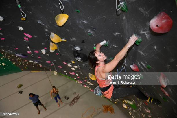 LOUISVILLE CO OCTOBER 25 Maureen Beck looks up for her next hand holds as she climbs on the overhanging wall at EVO Rock Fitness Climbing Gym on...