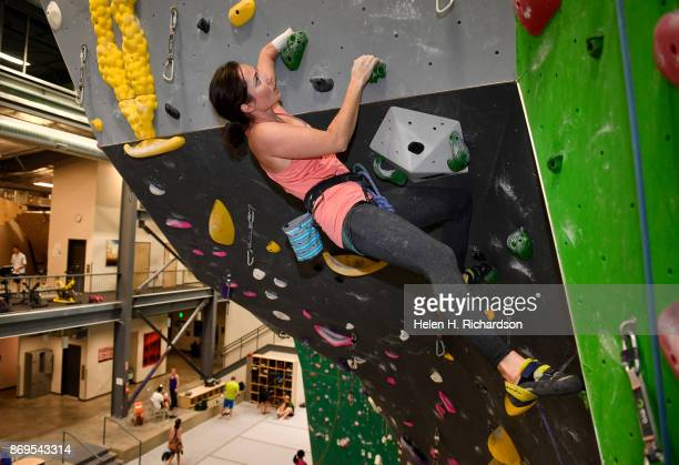 LOUISVILLE CO OCTOBER 25 Maureen Beck pulls on a hold to get over a roof on a climb on the overhanging wall at EVO Rock Fitness Climbing Gym on...