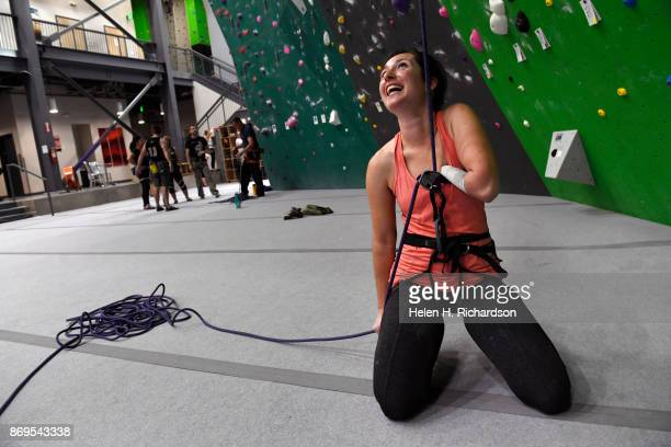LOUISVILLE CO OCTOBER 25 Maureen Beck smiles as she lowers her climbing partner Sarah Fountain after she climbed on the overhanging wall at EVO Rock...