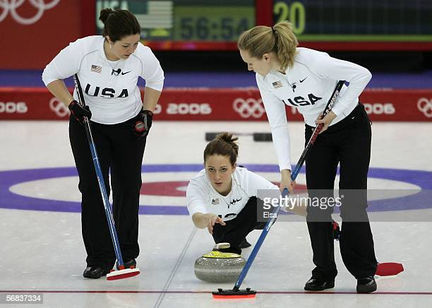 Maureen Brunt and Jamie Johnson of the United States sweep after Jessica Schultz delivered the stone during the preliminary round of the women's...