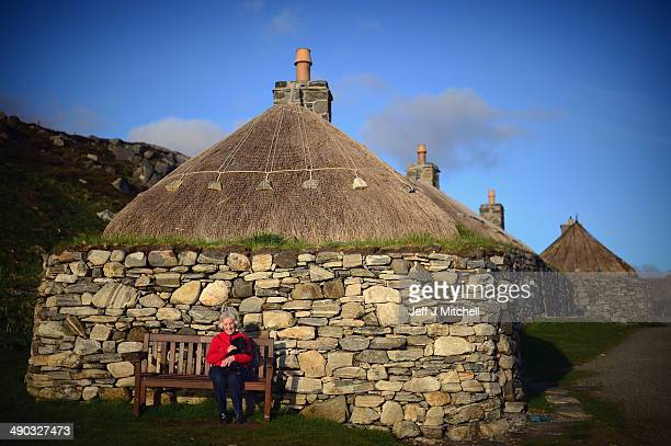 Maureen Chambers and her dog Cacie sit in the evening sun at Blackhouse Village on May 13 2014 in Lewis Scotland A recent study has shown that...