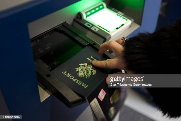 Maureen Chatelain of Atlanta GA scanned her passport as she used the new Global Entry System to clear custom at the Minneapolis Airport after...