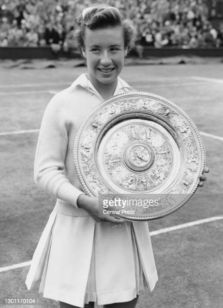 Maureen Connolly of the United States holds the Rosewater Plate after defeating compatriot Louise Brough during their Women's Singles Final match on...