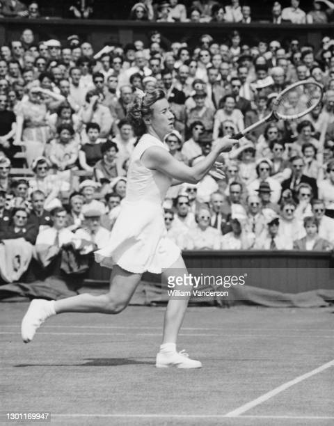 Maureen Connolly of the United States makes a running forehand return to Joan Scott of South Africa during their Women's Singles Second Round match...