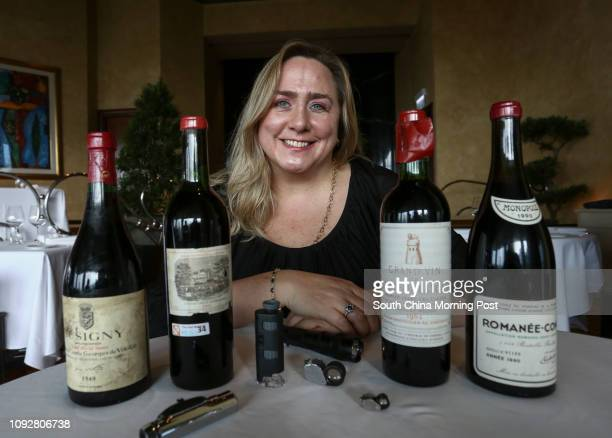 Maureen Downey fake wine expert samples bottles of wine at Grissini Grand Hyatt Hong Kong on February 07 2017 Bottles of wine Musigny Cuvee Vielles...