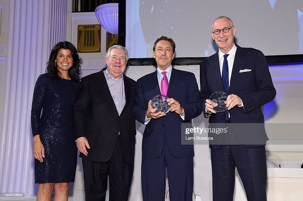 Maureen J. Reidy, Frank A. Bennack, George Bodenheimer and John Skipper pose on stage at the Paley Prize Gala honoring ESPN's 35th anniversary presented by Roc Nation Sports on May 28, 2014 in New York City.