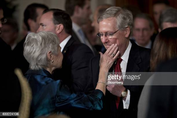 Maureen McCarthy Scalia wife of former US Supreme Court Justice Antonin Scalia touches the face of Senate Majority Leader Mitch McConnell a...
