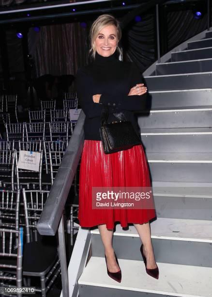Maureen McCormick poses at Dancing with the Stars Season 27 Finale at CBS Television City on November 19 2018 in Los Angeles California