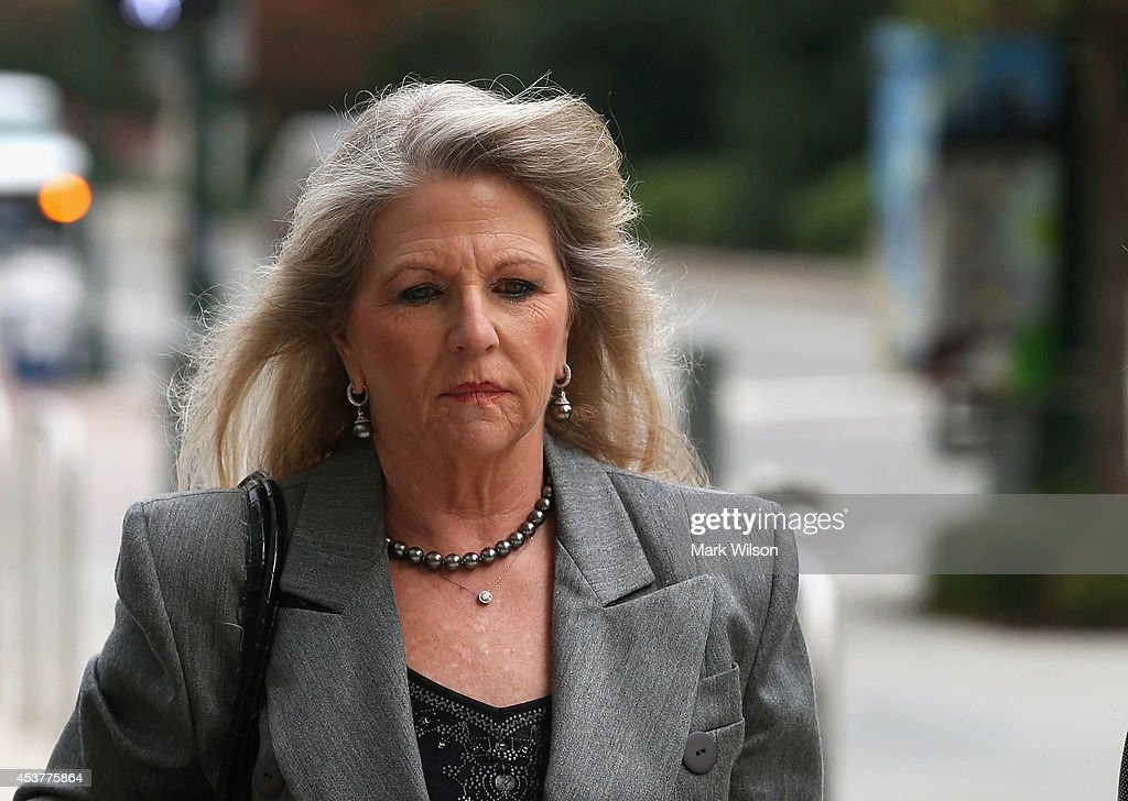 Maureen McDonnell walks to her corruption trial at U.S. District Court for the Eastern District of Virginia, August 18, 2014 in Richmond, Virginia. McDonnell and her husband Former Virginia Governor Robert McDonnell are on trial for accepting gifts, vacations and loans from a Virginia businessman in exchange for helping his company.