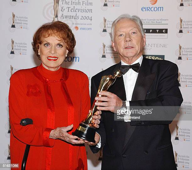 Maureen O'Hara and Gay Byrne pose at the Irish Film and Television Awards in the Burlington Hotel on October 30 2004 in Dublin Ireland