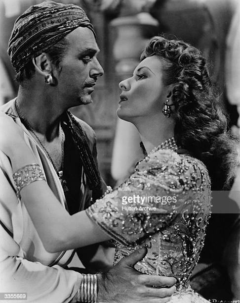 Maureen O'Hara finds Douglas Fairbanks Junior hard to resist in RKO's production of 'Sinbad the Sailor'.