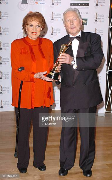 Maureen O'Hara holding her Lifetime Achievement Award recipient with Guy Byrne