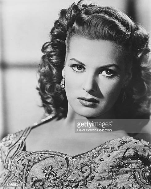 Maureen O'Hara Irish actress wearing a beaded top with a scalloped neckline in a studio portrait circa 1950