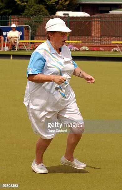 Maureen Parker skip of the New Lynn Bowling Club's womens four of Hetty Bolscher Norma Stewart and Janis Scott runs down the green on the way to...