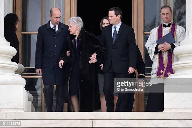Maureen Scalia widow of US Supreme Court Associate Justice Antonin Scalia is escorted by family members as she walk out of the court building to...