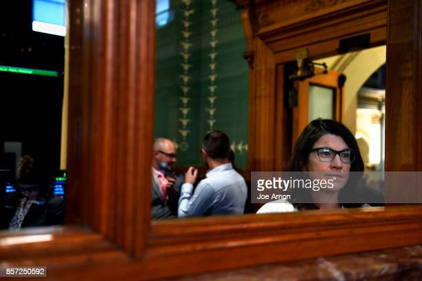 Maureen Welch MA a lobbyist for intellectual developmental disabilities watches lawmakers that were called back to the Capitol for a legislative...