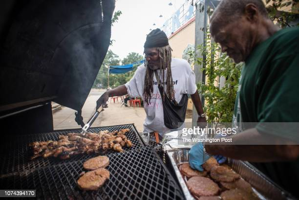 Maurice AbbeyBey left runs the grill during the event that he helped organize At right is Alvin Wynn an advocate with the Chosen Few The Chosen Few...