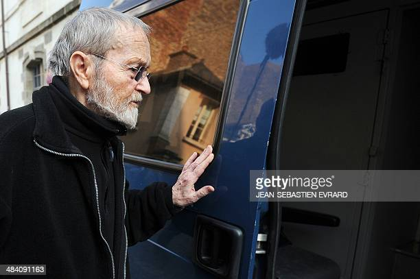 Maurice Agnelet prepares to enter a police car after hearing the verdict of his third trial on April 11 2014 at the Rennes courthouse western France...