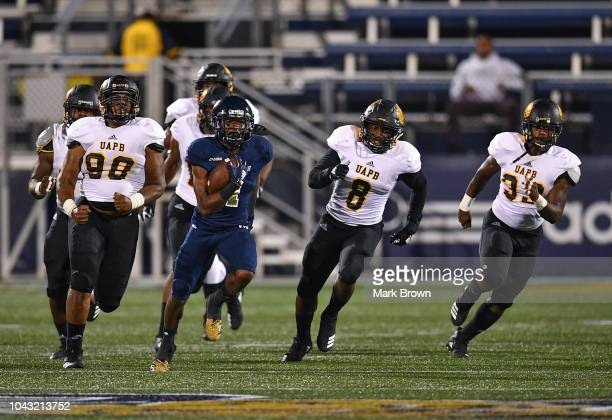 Maurice Alexander of the FIU Golden Panthers runs for a touchdown during the first half against the ArkansasPine Bluff Golden Lions at Ricardo Silva...