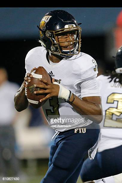 Maurice Alexander of the Florida International Golden Panthers scrambles out of the pocket with the ball against the Central Florida Knights on...