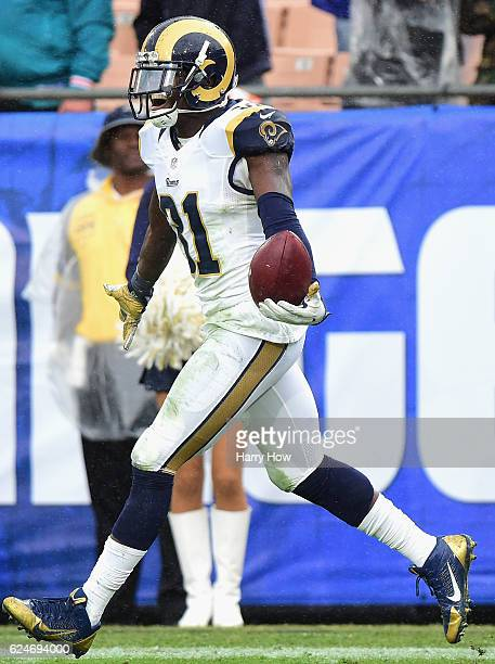 Maurice Alexander of the Los Angeles Rams celebrates his interception in the end zone against the Miami Dolphins during the third quarter of the game...