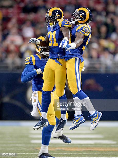 Maurice Alexander of the St Louis Rams celebrates with teammates after making a sack in the second quarter against the Arizona Cardinals at the...