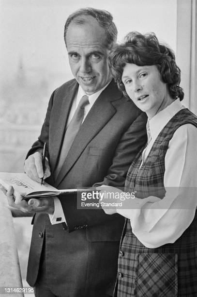 Maurice and Maralyn Bailey sign a copy of their new book '117 Days Adrift', UK, 22nd April 1974. The book chronicles their experiences in 1973, when...