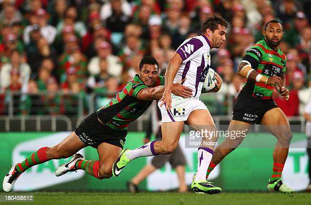 Maurice Blair of the Storm is tackled by Dylan Farrell of the Rabbitohs during the NRL Qualifying match between the South Sydney Rabbitohs and the...