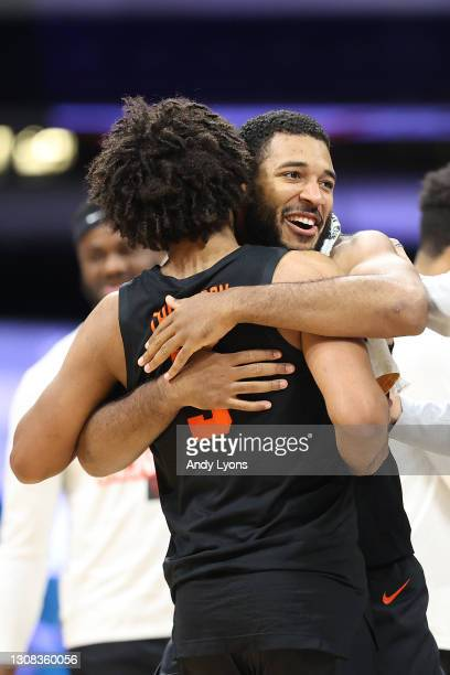 Maurice Calloo and Ethan Thompson of the Oregon State Beavers celebrate their 80-70 win over the Oklahoma State Cowboys during the second half in the...