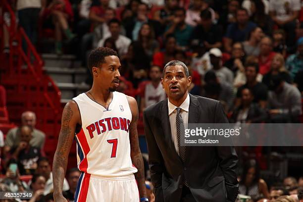 Maurice Cheeks Head Coach of the Detroit Pistons shares a word with Brandon Jennings during the game against the Miami Heat on December 3 2013 at...
