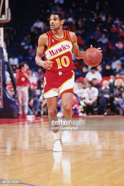 Maurice Cheeks of the Atlanta Hawks dribbles against the Atlanta Hawks during a game played circa 1990 at the Omni in Atlanta Georgia NOTE TO USER...