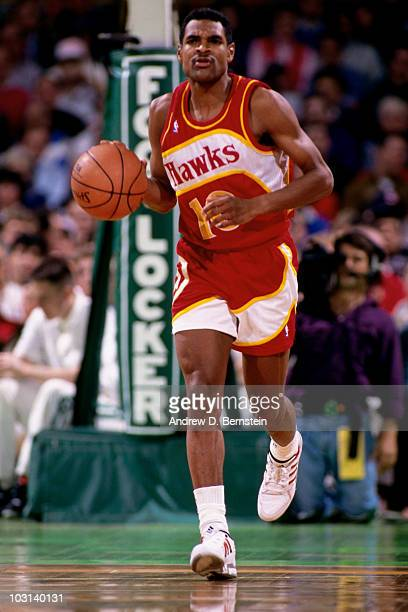 Maurice Cheeks of the Atlanta Hawks dribbles during a game played in 1991 at the Omni in Atlanta Georgia NOTE TO USER User expressly acknowledges and...
