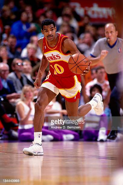 Maurice Cheeks of the Atlanta Hawks dribbles the basketball down the court against the Los Angeles Lakers in circa 1991 at the Forum in Inglewood...