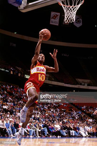 Maurice Cheeks of the Atlanta Hawks shoots the basketball against the New Jersey Nets in circa 1991 at the Brendan Byrne Arena in East Rutherford New...