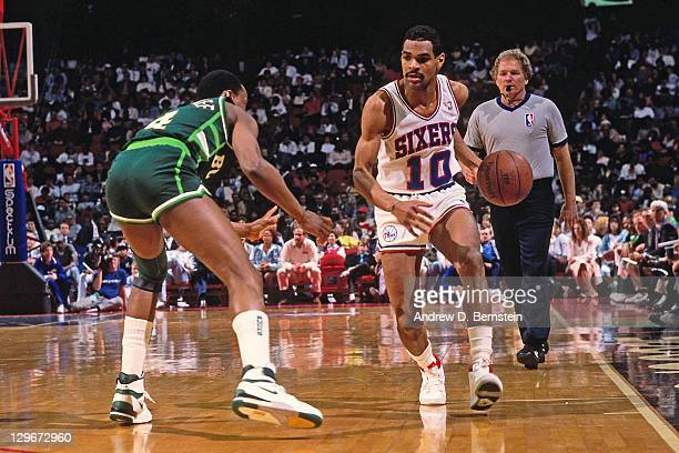 Maurice Cheeks of the Philadelphia 76ers dribbles against Sidney Moncrief of the Milwaukee Bucks circa 1987 NOTE TO USER User expressly acknowledges...