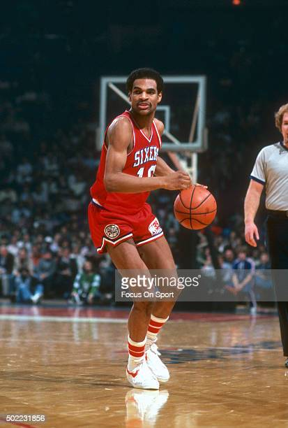 Maurice Cheeks of the Philadelphia 76ers dribbles the ball against the Washington Bullets during an NBA basketball game circa 1981 at the Capital...