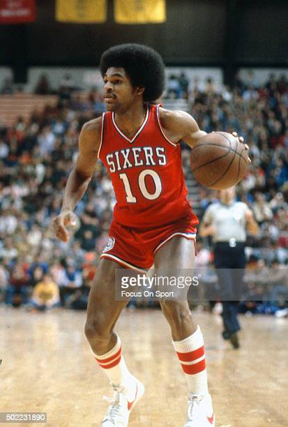 Maurice Cheeks of the Philadelphia 76ers dribbles the ball against the New Jersey Nets during an NBA basketball game circa 1978 at the Rutgers...