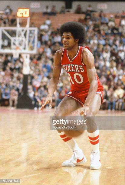 Maurice Cheeks of the Philadelphia 76ers dribbles the ball against the New  Jersey Nets during an a0967af25