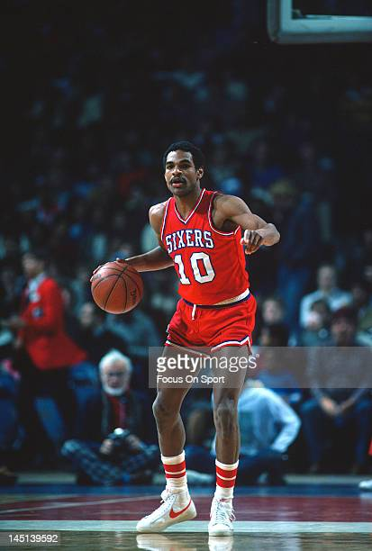 Maurice Cheeks of the Philadelphia 76ers dribbles the ball up court against the Washington Bullets during an NBA basketball game circa 1984 at the...