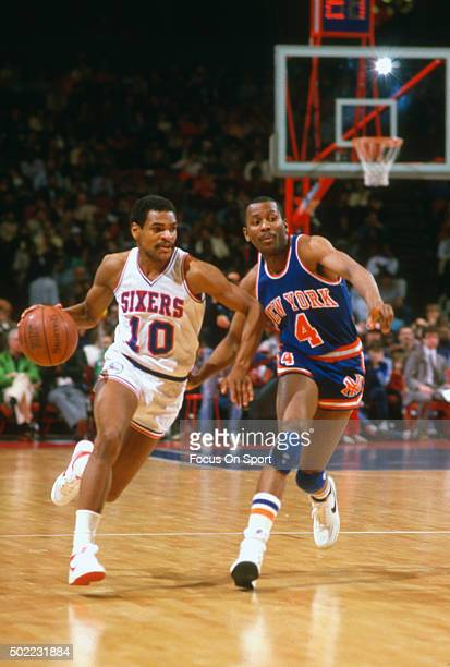 Maurice Cheeks of the Philadelphia 76ers drives on Darryl Walker of the New York Knicks during an NBA basketball game circa 1983 at The Spectrum in...