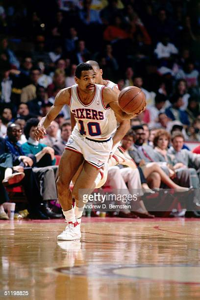 Maurice Cheeks of the Philadelphia 76ers drives the ball up court during an NBA game in 1987 NOTE TO USER User expressly acknowledges and agrees that...