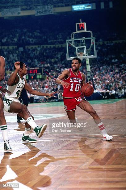Maurice Cheeks of the Philadelphia 76ers drives the ball up court against Gerald Henderson of the Boston Celtics during a game played in 1981 at the...