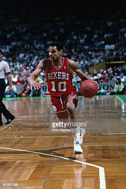 Maurice Cheeks of the Philadelphia 76ers drives to the basket against the Boston Celtics during a game played in 1988 at the Boston Garden in Boston...