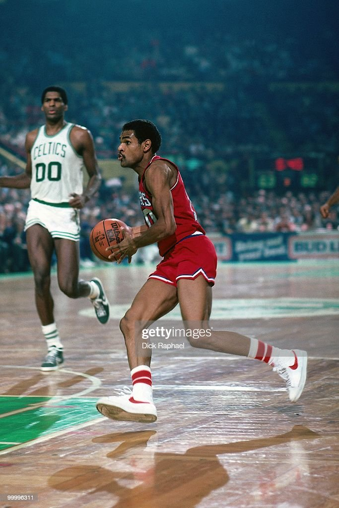 Maurice Cheeks #10 of the Philadelphia 76ers drives to the basket against the Boston Celtics during a game played in 1983 at the Boston Garden in Boston, Massachusetts.