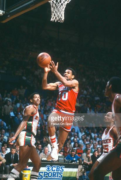 Maurice Cheeks of the Philadelphia 76ers goes in for a layup against the Milwaukee Bucks during an NBA basketball game circa 1983 at the MECCA Arena...