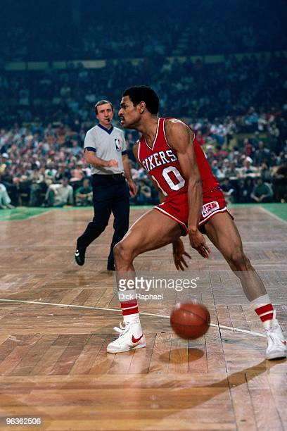 Maurice Cheeks of the Philadelphia 76ers makes a move with the ball during a game against the Boston Celtics played in 1980 at the Boston Garden in...
