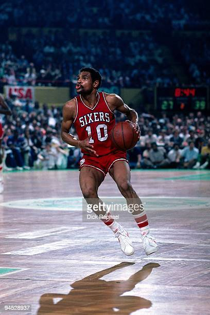 Maurice Cheeks of the Philadelphia 76ers moves the ball up court against the Boston Celtics during a game played in 1982 at the Boston Garden in...