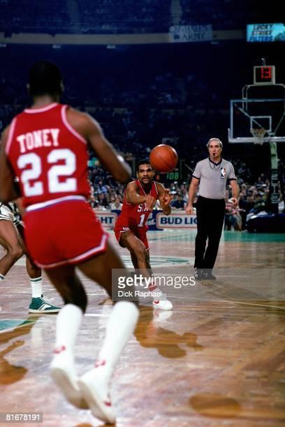 Maurice Cheeks of the Philadelphia 76ers passes against the Boston Celtics circa 1983 at the Boston Garden in Boston Massachusetts NOTE TO USER User...